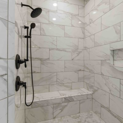 luxury marble shower with black hardware